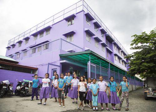 Purple school with students